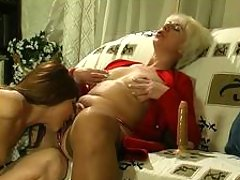 Blonde mature gal tasting fresh pussy before steamy dildotoying on armchair