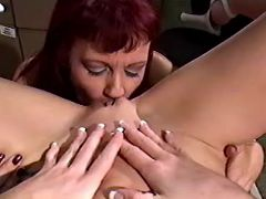 Lesbo mature licks and dildos young pussy on table