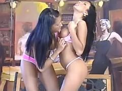 Brunette lesbians caress each other